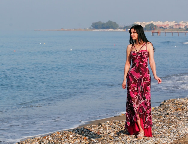 Young beautiful woman on the sea in summer