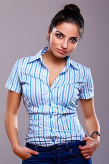 Young and beautiful woman in striped blouse