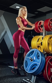 Young beautiful woman training in the gym. concept of fitness, workout, sport, health