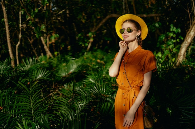 Young beautiful woman in the tropical jungle