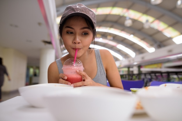 Young beautiful woman vlogging with mobile phone in restaurant