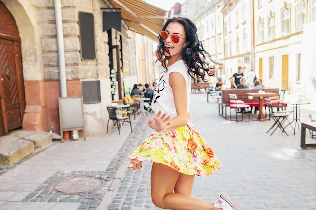 Young beautiful woman walking in old city street
