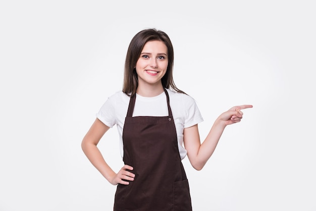 Young beautiful woman wearing clean gloves and pointing to the side