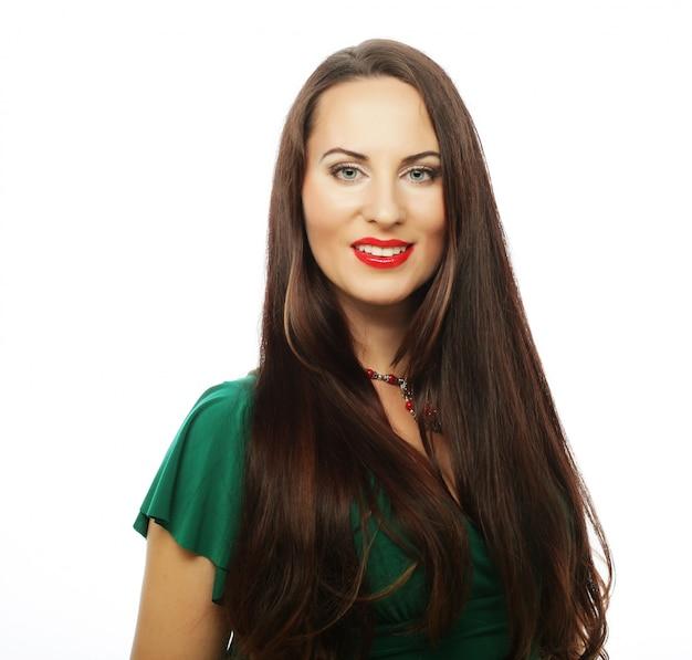 Young beautiful woman wearing green dress