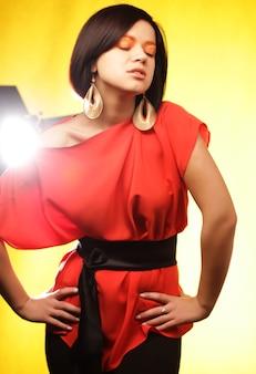 Young beautiful woman wearing a red dress