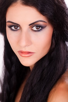 Young and beautiful woman with bright make up