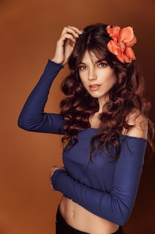 Young beautiful woman with flowers in her hair and  makeup, toning photo