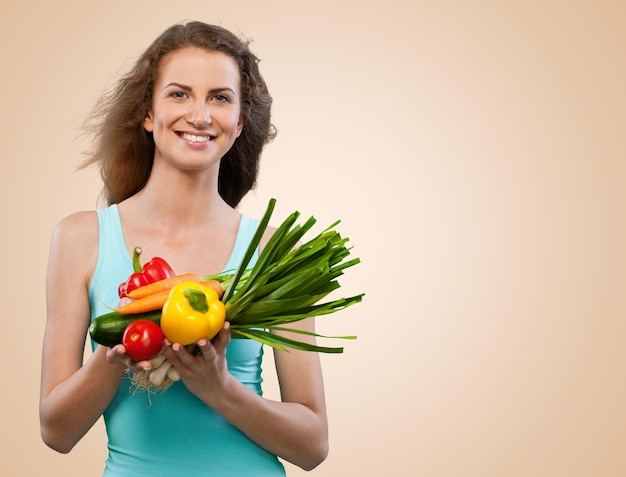Young beautiful woman with fresh vegetables