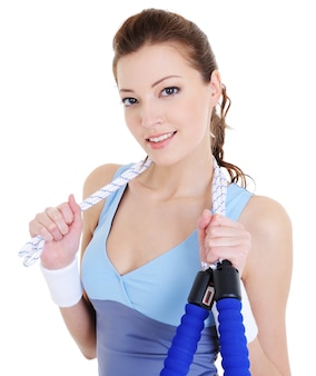 Young beautiful woman with skipping rope - white space
