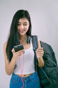 Young beautiful woman with smartphone