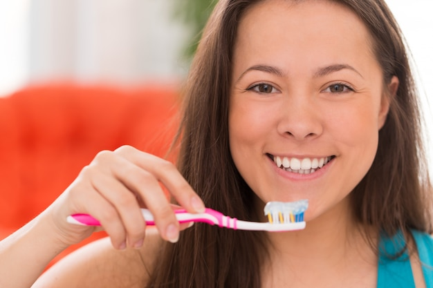 Young beautiful woman with toothbrush