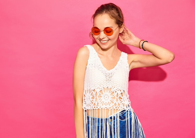 Young beautiful women . trendy women in casual summer clothes. positive female emotion facial expression body language. funny model isolated on pink wall