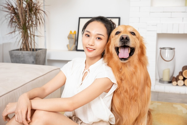 Young beauty and golden retriever are happy together
