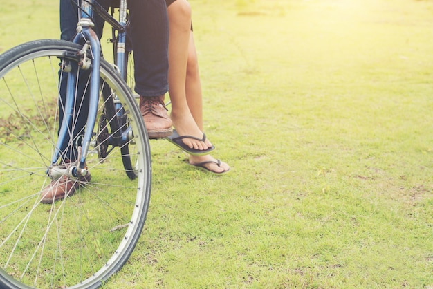 Young bicycle feet enjoyment opposite
