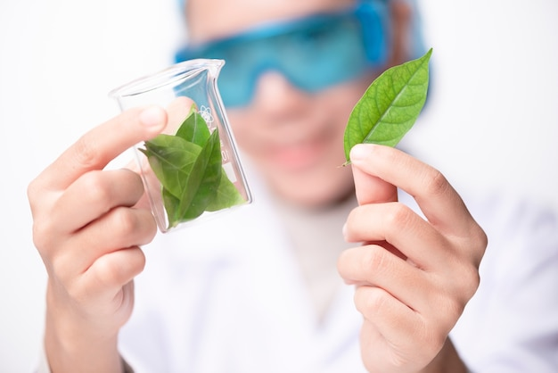 Young biotechnology scientist chemist working in lab