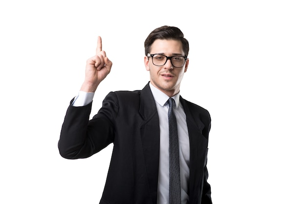 Young bisnessman in glasses, tie and black suit point a finger up, isolated on white
