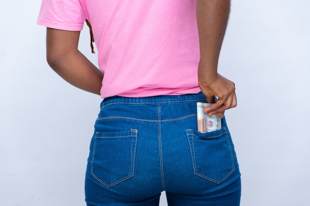 Young black lady puts some monet into her back pocket.