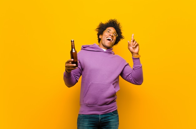Young black man with a beer