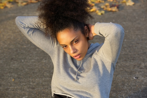 Young black woman exercising by sit ups