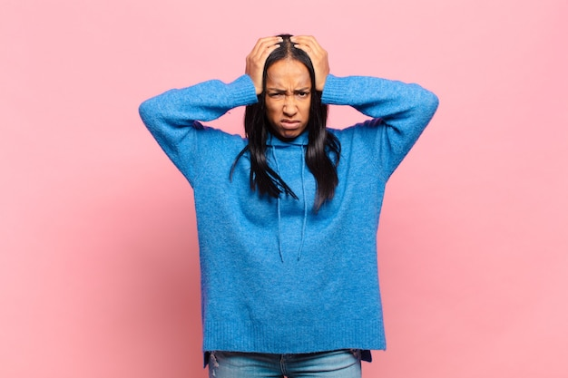 Young black woman feeling frustrated and annoyed, sick and tired of failure, fed-up with dull, boring tasks