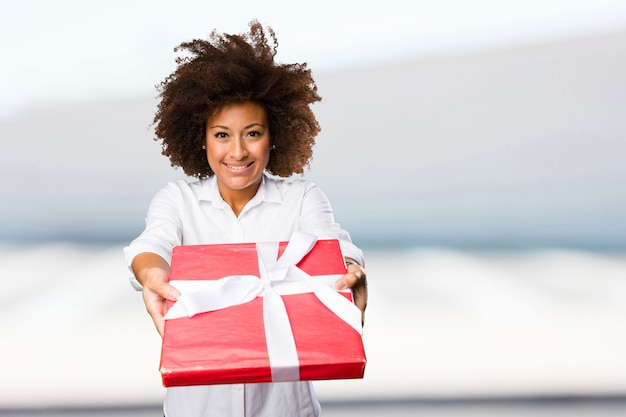 Young black woman holding a gift