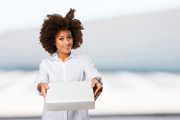 Young black woman holding a white box