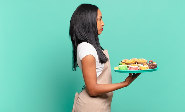 Young black woman on profile view looking to copy space ahead