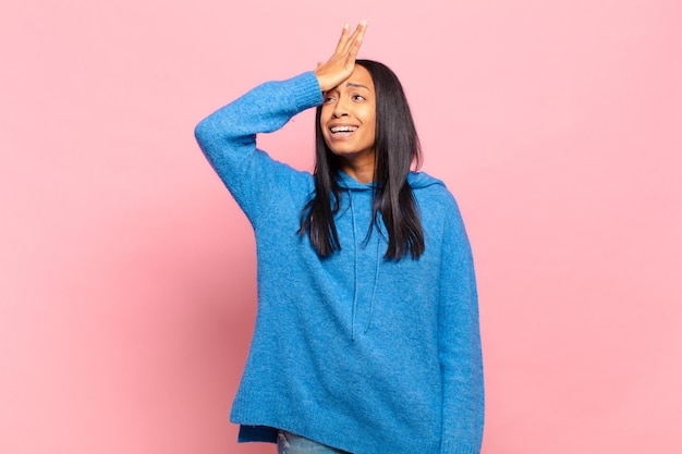 Young black woman raising palm to forehead thinking oops, after making a stupid mistake or remembering, feeling dumb