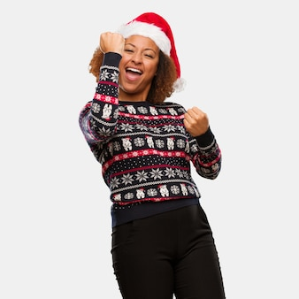 Young black woman in a trendy christmas sweater with print who does not surrender