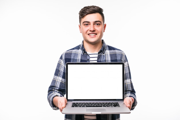 Young blackhaired man demonstrating something on bright laptop