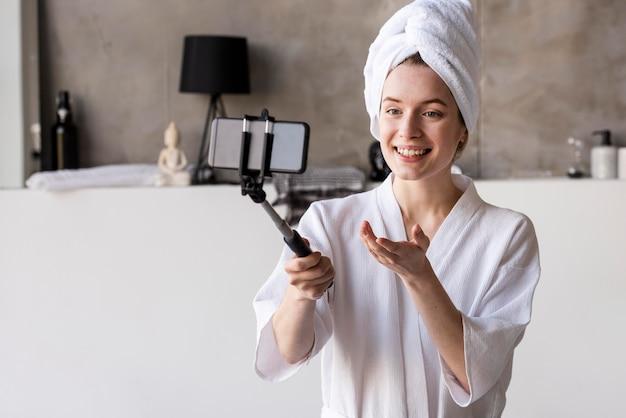 Young blogger recording in bathrobe