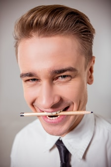 Young blond businessman in white classical shirt.