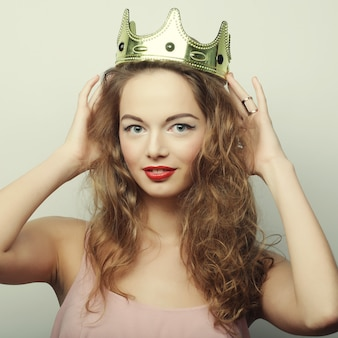 Young blond woman in crown