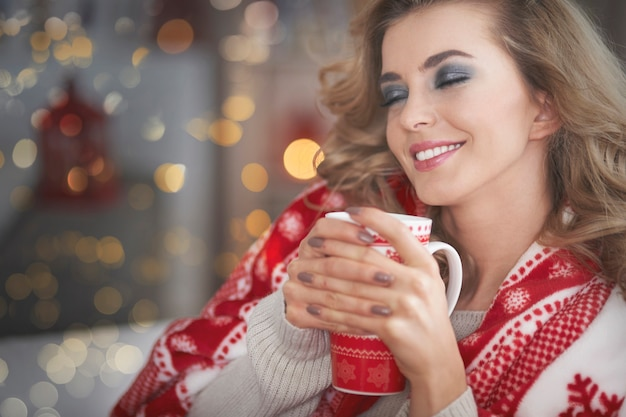 Young blond woman drinking hot chocolate