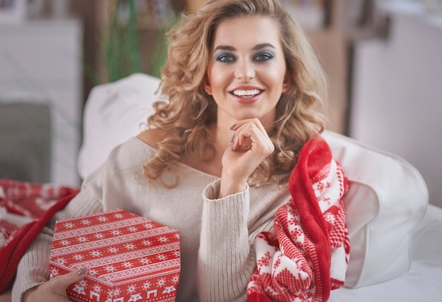 Young blond woman holding christmas present