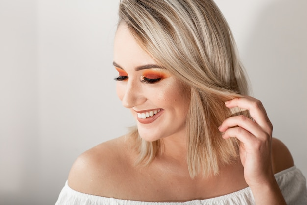 Young blond woman with bright makeup