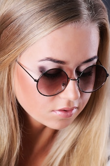 Young blond woman with sunglasses portrait