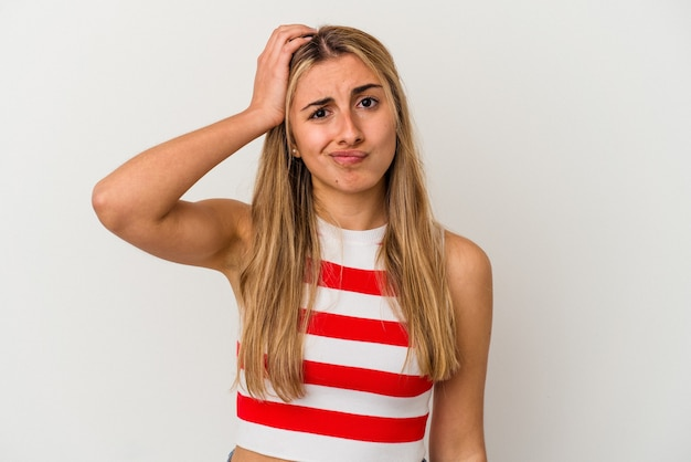 Young blonde caucasian woman on white background isolated being shocked, she has remembered important meeting.