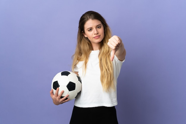 Young blonde football player woman isolated showing thumb down with negative expression