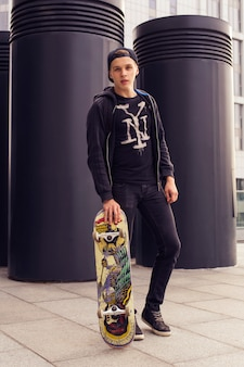 Young blonde guy with a skateboard