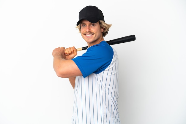 Young blonde man isolated playing baseball