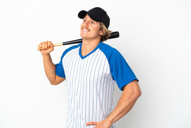 Young blonde man playing baseball isolated posing with arms at hip and smiling