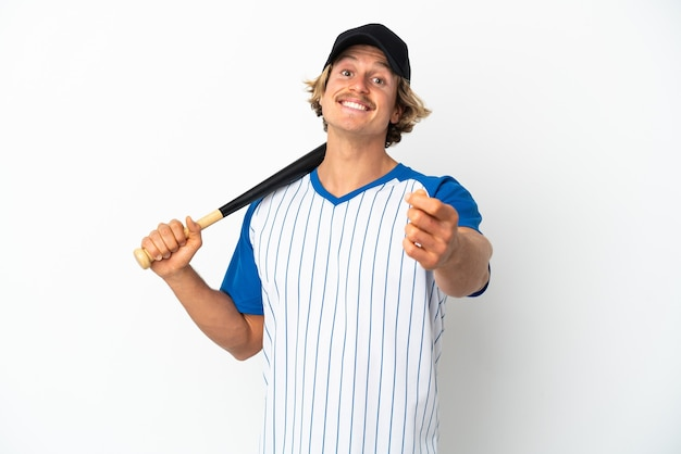 Young blonde man playing baseball isolated on white background making money gesture