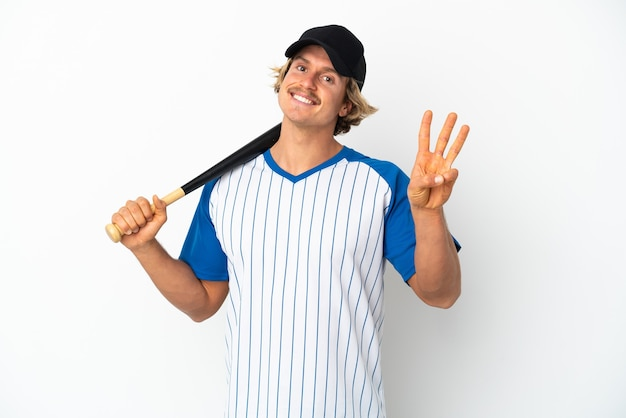 Young blonde man playing baseball isolated on white wall happy and counting three with fingers