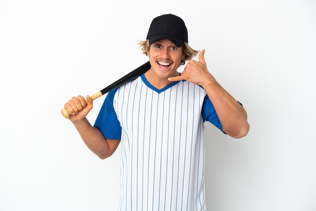 Young blonde man playing baseball isolated on white wall making phone gesture. call me back sign