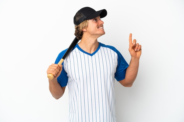 Young blonde man playing baseball isolated on white wall pointing up a great idea