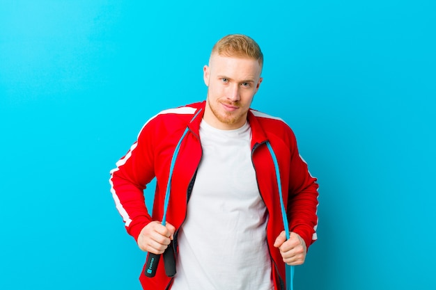 Young blonde man wearing sports clothes