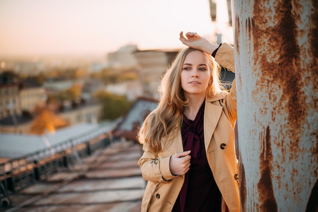 Young blonde posing at sunset