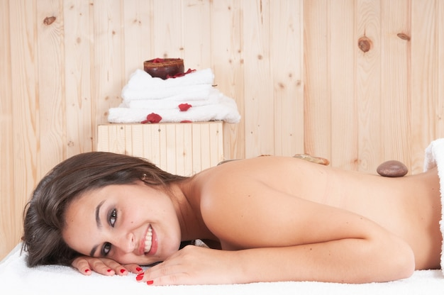 Young blonde relaxed on the table after a treatment in a massage parlor
