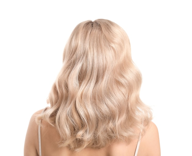 Young blonde with beautiful hair on white surface